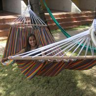 Fabric-hammock in fine stripes with round sticks