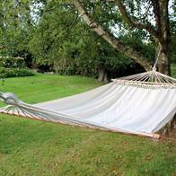 Comfortable natural white hammock with wooden bar for one or two people. 86405